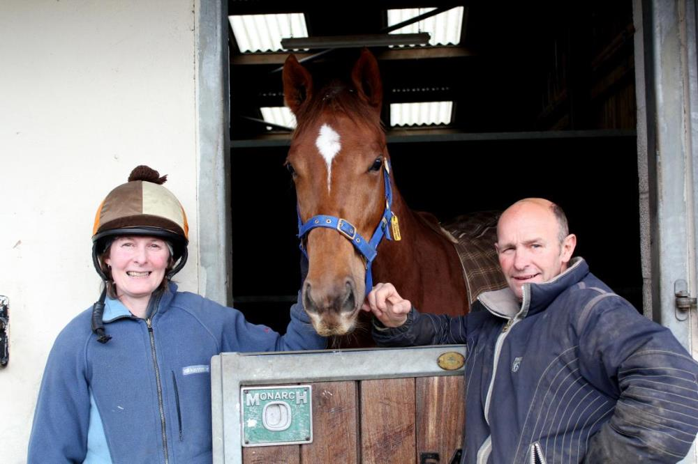 Anna and Allen pose with filly by Helmet, 'Fascinator'.